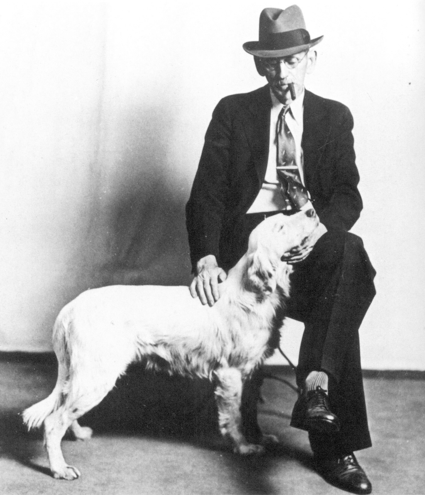 Dr William Whittenberg petting his dog